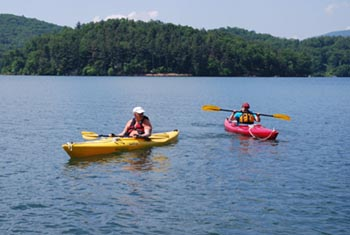 Kayaking in the mountains on Lake Glenville, North Carolina.